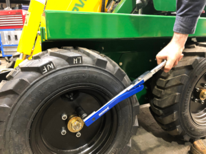 Checking tyre nut bolts on kanga mini Loader